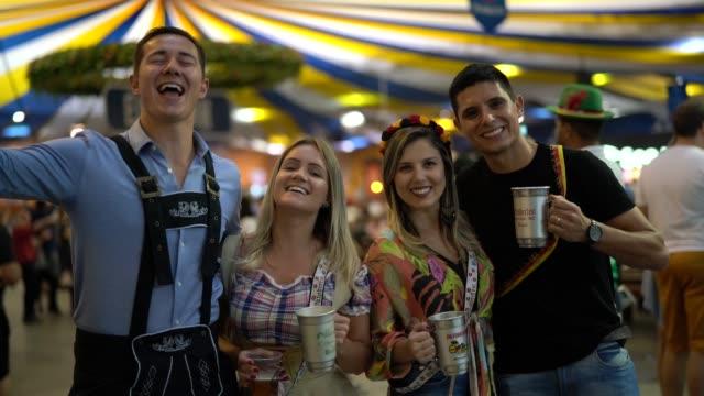 friends portrait at oktoberfest in blumenau, santa catarina, brazil - traditional clothing stock videos & royalty-free footage