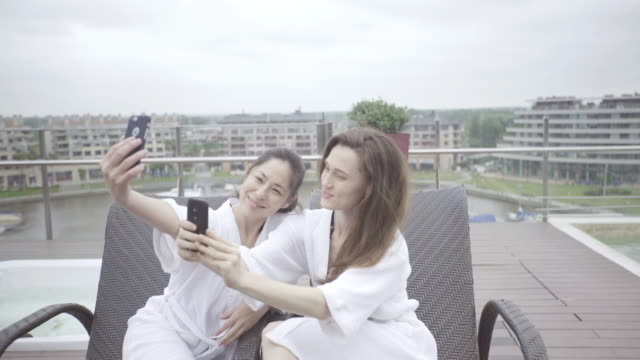 friends posing for selfie at luxury spa - adirondack chair stock videos & royalty-free footage