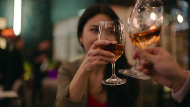 friends raise a toast at dinner - auckland stock videos & royalty-free footage