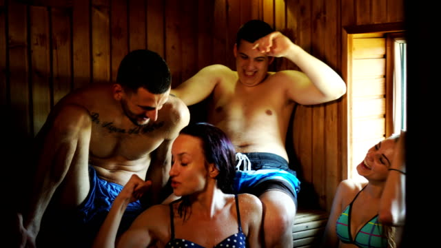 friends relaxing in sauna - sauna stock videos and b-roll footage