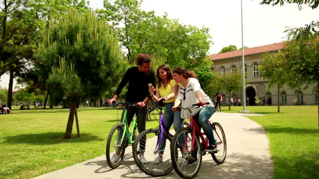 Friends riding bicycles