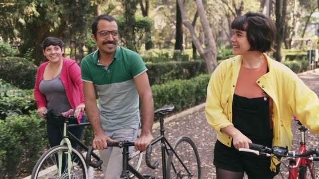 friends riding bikes in mexico city - public park stock videos & royalty-free footage