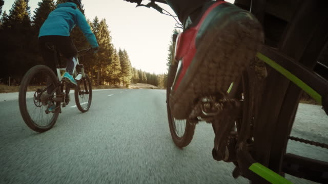 pov friends riding bikes through countryside - human foot stock videos & royalty-free footage