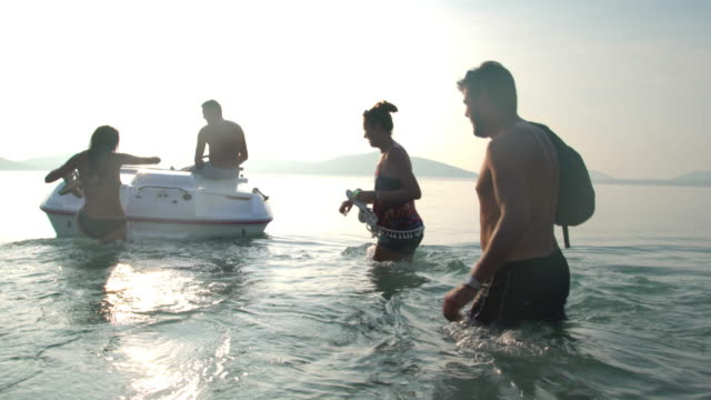 friends riding speedboat 4k - motorboat stock videos and b-roll footage