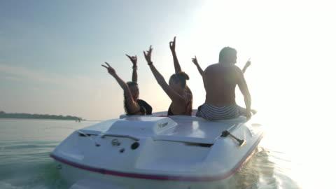 friends riding speedboat 4k - speed boat stock videos & royalty-free footage