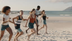 Friends running and enjoying on the beach vacation