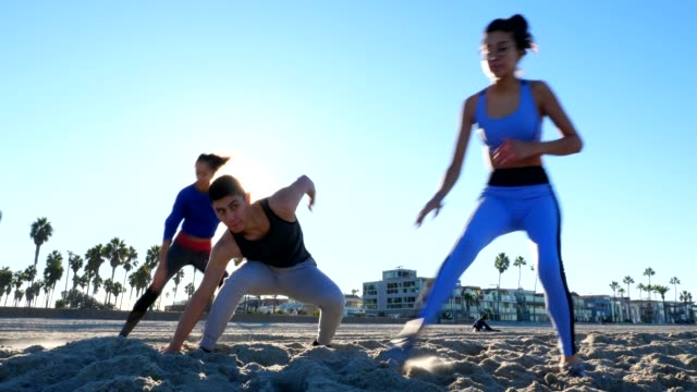 MS Friends running sprints on beach during early morning workout
