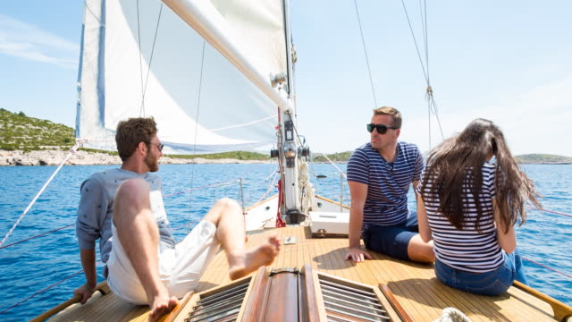 WS friends sailing in mediterranean sea on classic wooden sailing yacht