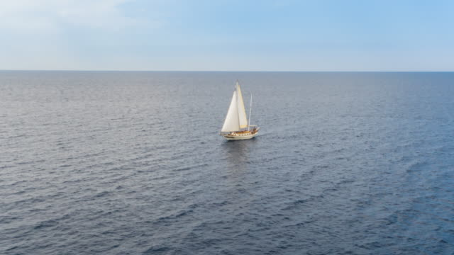 ha ws friends sailing in mediterranean sea on vintage wooden yacht - sail stock videos and b-roll footage