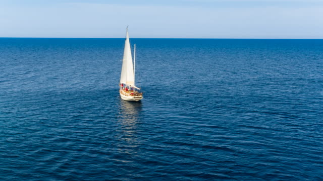 ha ws friends sailing in mediterranean sea on vintage wooden yacht - sailing boat stock videos and b-roll footage