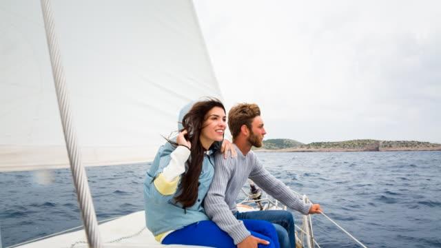 MS friends sailing in stormy mediterranean sea on modern yacht
