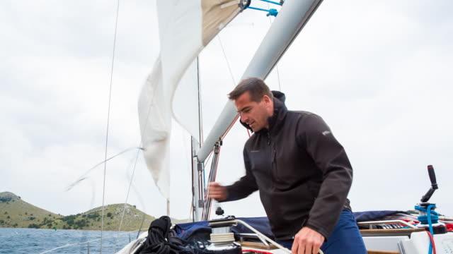 ms friends sailing in stormy mediterranean sea on modern yacht - segel stock-videos und b-roll-filmmaterial