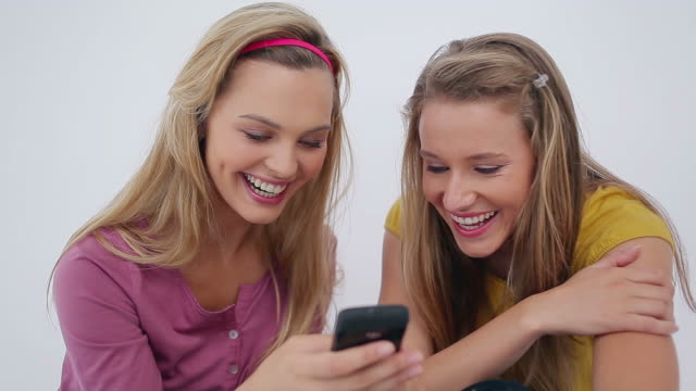 friends sending a textmessage together - hair accessory stock videos & royalty-free footage