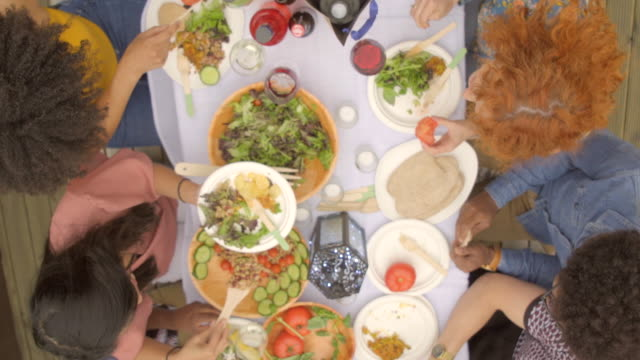friends serve up a healthy lunch - vegan food stock videos & royalty-free footage