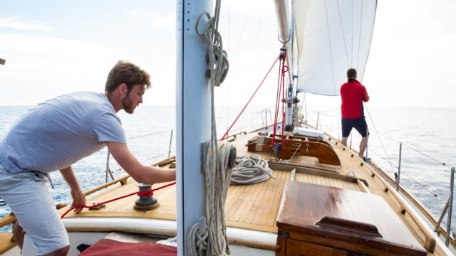 WS friends setting sail in mediterranean sea on classic wooden yacht