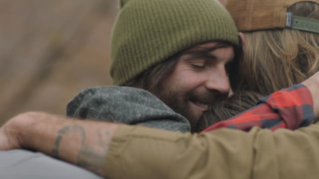 cu. friends share group hug. - embracing stock videos & royalty-free footage