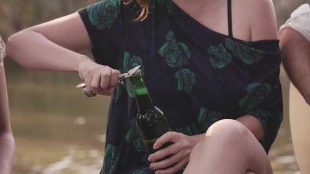 friends sharing beer while on a picnic - bottle opener stock videos & royalty-free footage