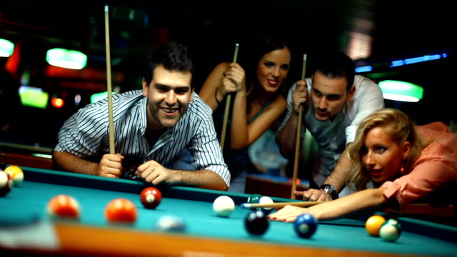 friends shooting pool. - pool table stock videos & royalty-free footage