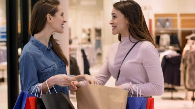 friends shopping - spending money stock videos & royalty-free footage