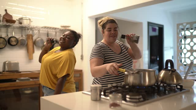 friends singing and dancing while cooking at home - kitchen stock videos & royalty-free footage