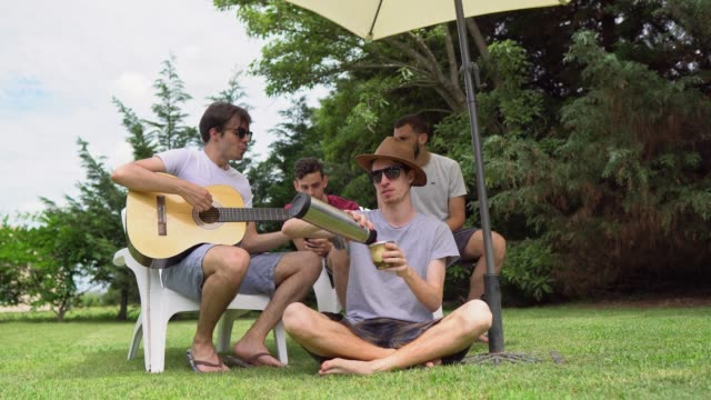 friends singing and playing guitar in home yard - argentinian ethnicity stock videos & royalty-free footage
