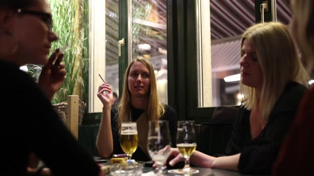 friends sit at tables in a bar while plexiglass separates areas in the bar during the coronavirus pandemic on october 16, 2020 in zurich,... - smoking stock videos & royalty-free footage
