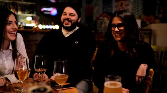 Friends sitting in bar