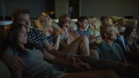 friends sitting on sofa watching comedy movie on television / cedar hills, utah, united states - boyfriend stock videos & royalty-free footage