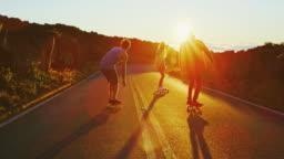 Friends Skateboarding at Sunset