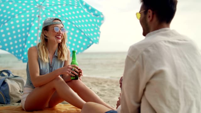 friends spending beautiful day on the beach - parasol stock videos & royalty-free footage