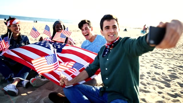 friends take a selfie for the fourth of july - guy waving stock videos & royalty-free footage