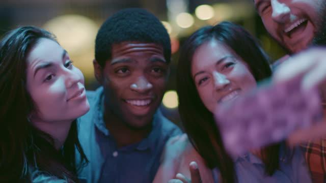 Friends take selfie in nightclub in slow motion