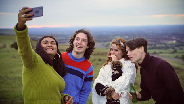 friends taking a selfie against the beautiful countryside - east sussex stock videos & royalty-free footage
