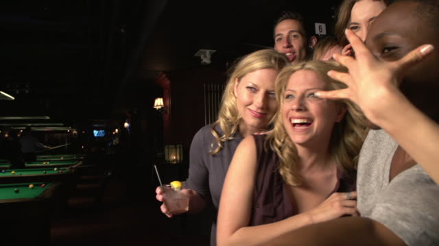 friends taking a selfie at a club