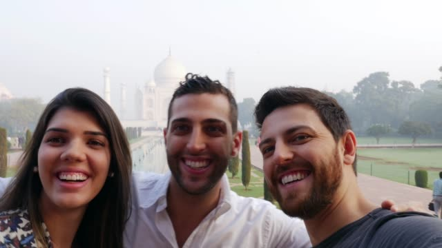 Friends taking a selfie of Taj Mahal, India