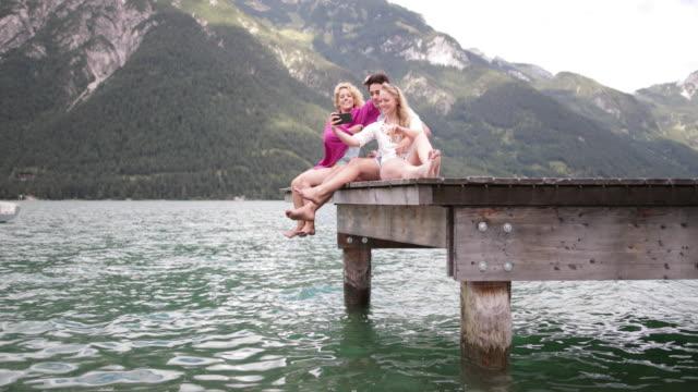 Friends taking a selfie on a jetty