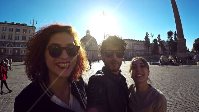 Friends taking a selfie stick in Rome