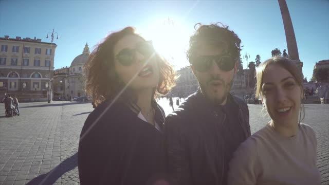 Friends taking a selfie video in Rome
