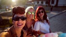 Friends taking selfie in the amusement park