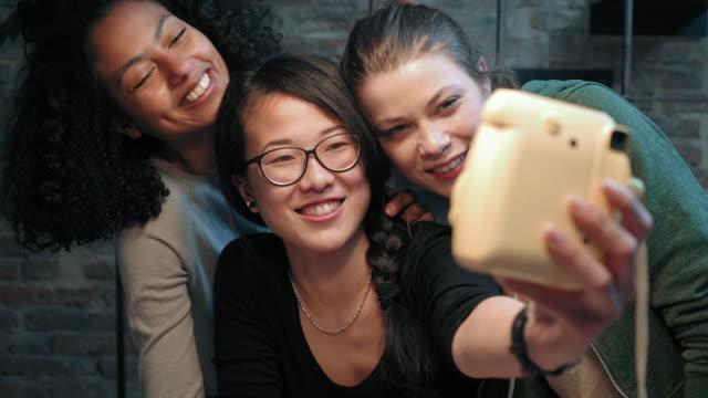 friends taking selfie - polaroid camera stock videos & royalty-free footage