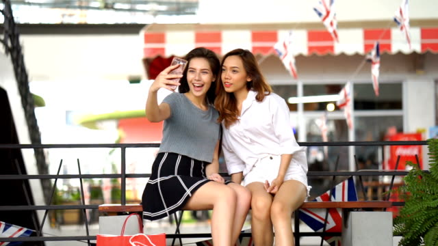 friends taking selfie with mobile phone - teenage girls stock videos & royalty-free footage