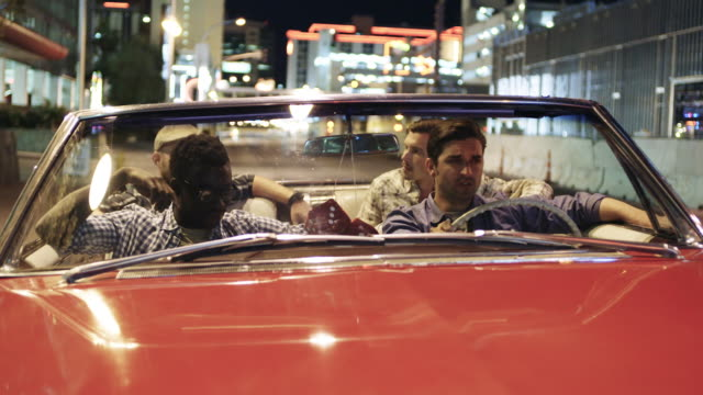 Friends talk as they wait at stoplight in downtown Vegas