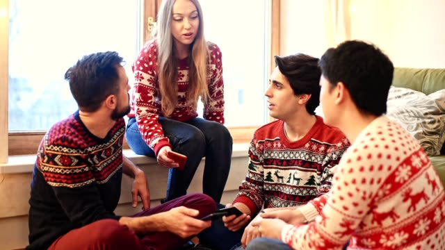 friends talking at home for christmas - cantare video stock e b–roll