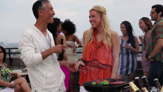 MS Friends talking each other and cooking at party / Brooklyn, New York, United States