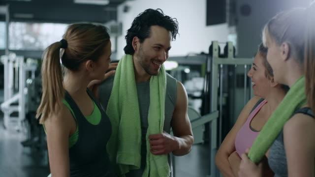 Friends talking in gym