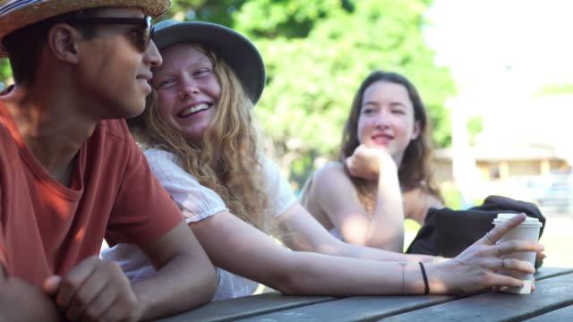 Friends talking in the park