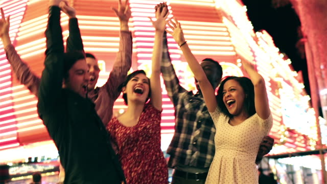 friends throw their hands in the air and cheer outside casino in downtown las vegas - arms raised stock videos & royalty-free footage