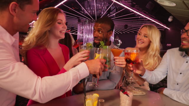 friends toasting at the bar - social gathering stock videos & royalty-free footage
