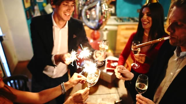 friends toasting at the party for the new year - anniversary stock videos & royalty-free footage