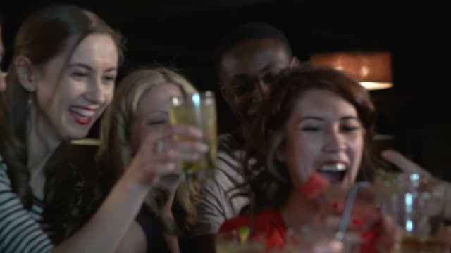 friends toasting cocktails at a club - bar video stock e b–roll